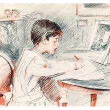 A boy is seen from the side sitting at a table and drawing from a book placed in front of him
