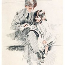 A boy is sitting on a couch with his younger sister and shows her something from a book