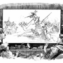 A group of people watches a screen showing a battle between people riding camels and horses
