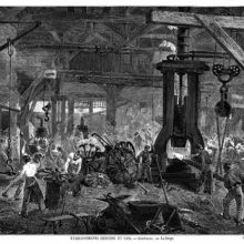 View of the forge at the Derosne & Cail Company showing workers heating and hammering metal parts