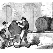 Three workers at a soap factory are moving an oil barrel up an inclined plane made of two planks