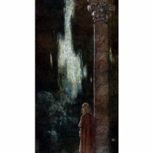 A young woman is seen from the back standing next to a tall column and staring out into the night