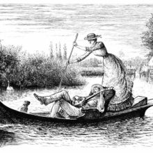 A man reclining on a small river boat plays the banjo as a woman pushs on the oar behind him