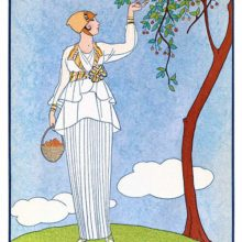 A woman is seen from the front delicately picking cherry plums from the tree to fill her basket