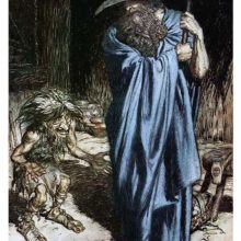 A man wrapped in a cloak stands upright, leaning on a spear as a fretful dwarf talks to him