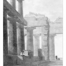 Doric colonnade of an ancient Greek temple at Paestum with an artist sitting on a stone