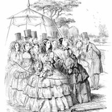 At a garden party, a young lady standing in front of other women is bending a bow