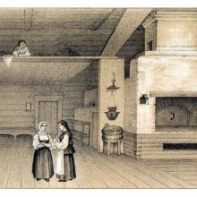 Two women stand in a spacious Russian country interior witha suspended bed area and an oven
