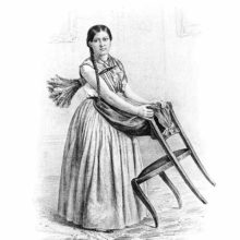 A woman with a feather duster tucked under her arm polishes the back of a chair with her apron