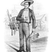 A dry-goods dealer stands in the middle of a street with a basket full of notions items on his arm