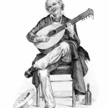 A smiling middle-aged man sits on a chair playing the twelve-string mandolin