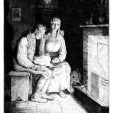 A man is sitting in front of a fireplace, reading from a book as his wife is sitting on a chair beside him