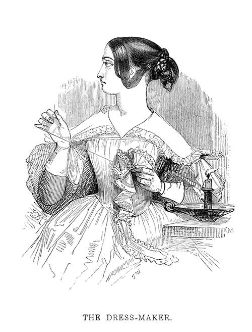 A woman looks to her right while her hand pulls on the thread with which she sews a piece of garment