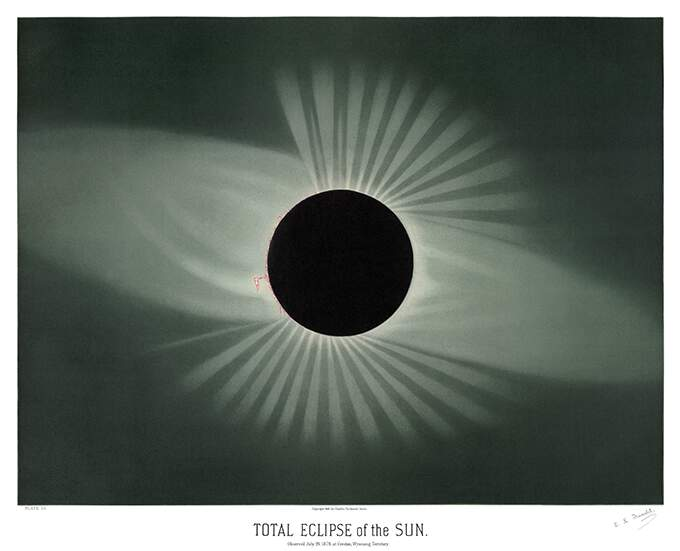 Solar eclipse showing the Moon covering the entire Sun's disk, with light radiating from behind