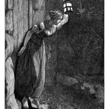 A young woman stands on a doorstep and holds up a lantern in front of her to peer into the night